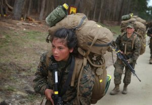 Can she do a dozen pull-ups in all this gear? Photo c/o misguidedchildren.com
