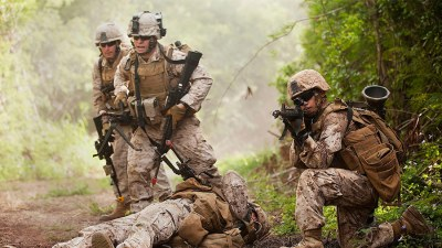 Marines with India Company, 3rd Battalion, 3rd Marine Regiment, respond to a simulated improvised explosive device detonation during counter-IED training at Marine Corps Training Area Bellows, Hawaii, on April 26, 2011. The training was part of a two-week evolution that allowed Marines to learn and practically apply counter-IED techniques under the watchful eye of instructors from the Marine Corps Engineer Center of Excellence.